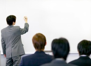 Businessman Writing on Whiteboard